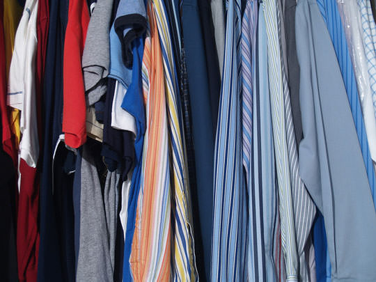 Closet full of owners clothes in vacation rental