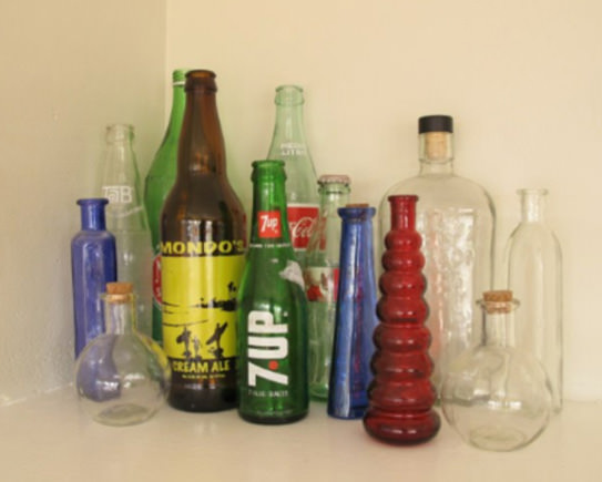 Assorted soda and other vintage bottles