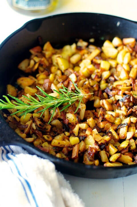 Skillet potatoes are a guest vacation breakfast favorite. Cast iron is superior to both stainless and non-stick for preparing them. Image courtesy of New South Food Co.